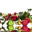 Holly berry and christmas balls — Stock Photo