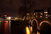 Amsterdam at night in the Netherlands — Stock Photo