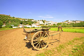 Agricultural area with hand cart with view on Aljezur in Portugal — Stock Photo
