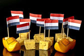 Dutch pickle cheese and clogs with dutch flags — Stock Photo