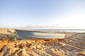 Boat at the beach at sunset — Stock Photo