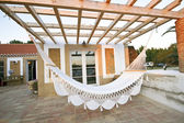 Hammock on terrace of bungalow — Stock Photo