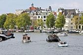 Classical Amsterdam view at the harbor from Amsterdam in the Netherlands — Foto Stock