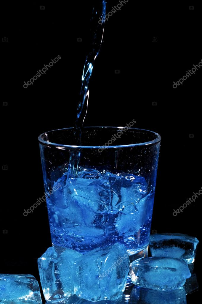 Blue curacao liquor pouring into a glass — Stock Photo #11501449