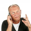 Man talking on mobile and gesturing — Stock Photo