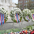 Wreaths on the Dam square during remembrance day in the Netherla — Stock Photo