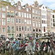 Old medieval facades and lots of bicycles in Amsterdam citycente — Stock Photo