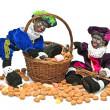 两个黑 piet 与一篮子的 gingernuts 和糖果 — 图库照片