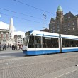 Tram driving at Dam square in Amsterdam Netherlands — Stock Photo #11869722