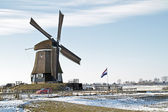 Ancient windmill in the countryside from the Netherlands in wint — Stock Photo