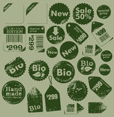 Set of vintage sale, bio and handmade grungy labels - collection — Stock Vector