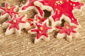Christmas biscuits stars golden and red — Stock Photo