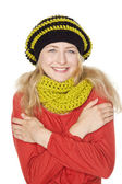 Blond young woman with wool hat and scarf — Stock Photo