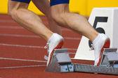 Runner in starting blocks — Stock Photo
