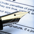 Stock Photo: Pen and tax form