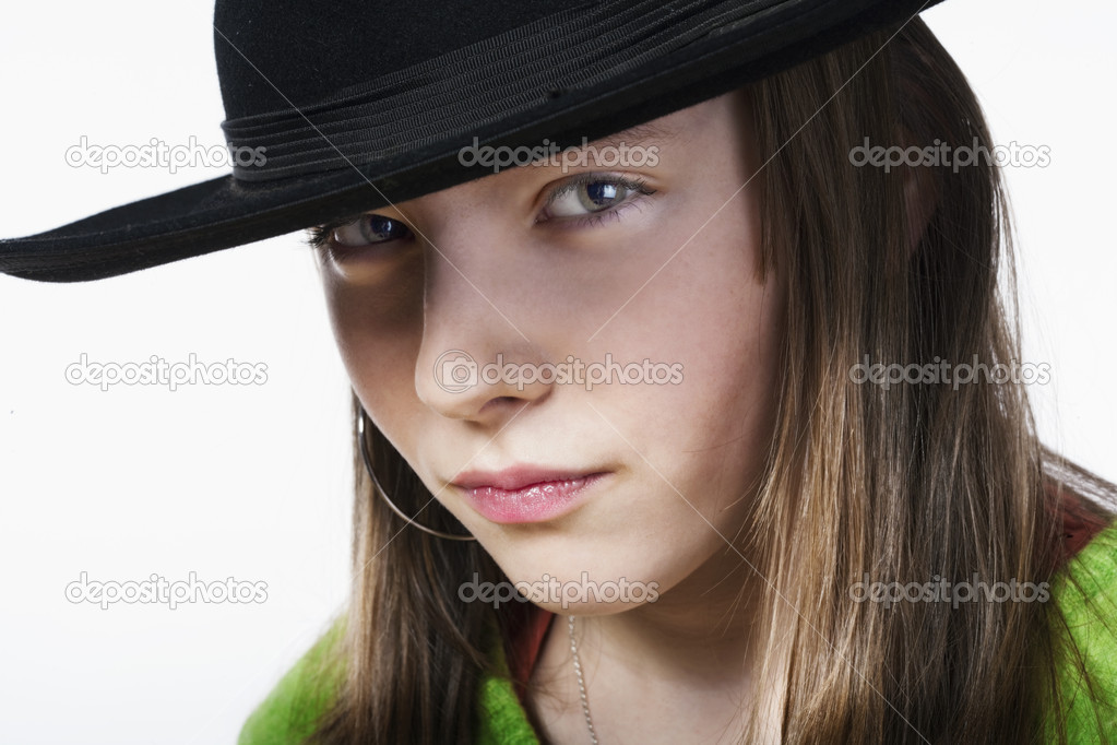 Studio portrait of a pretty, eleven years old girl  Stock Photo #11155790