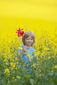 Boy with pinwheel — Stock Photo