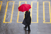 Pedestrain with umbrella — Stock Photo