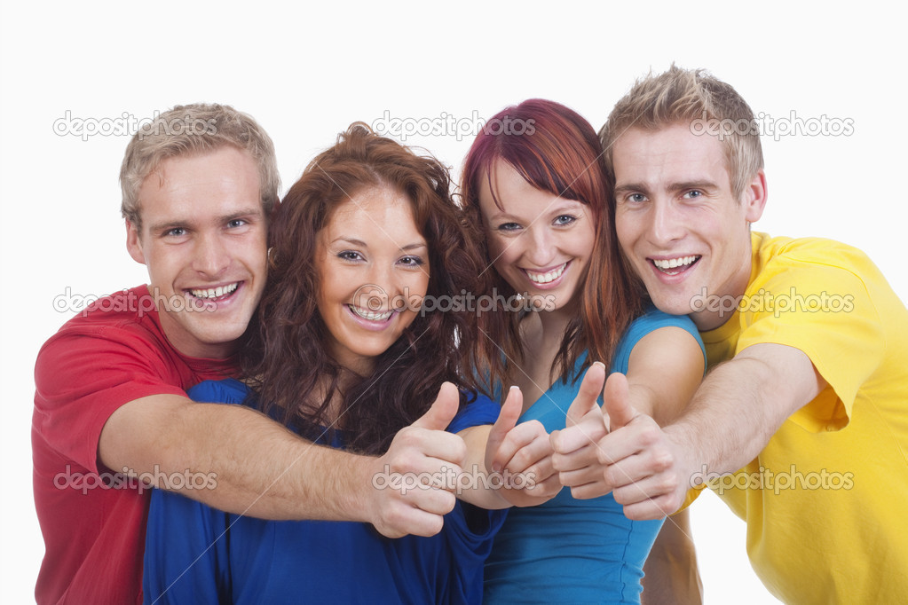 Portrait of a group of four happy young showing thumbs up sign — Stock Photo #11215894