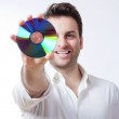 Man holding a cd — Stock Photo #11276439