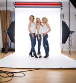 Three models in photographer studio — Stock Photo