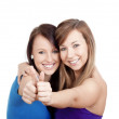 Girls showing thumbs uo — Stock Photo