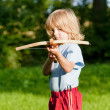 Stock Photo: Boy shooting with crossbow
