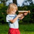 Boy shooting with crossbow — Stock Photo