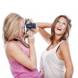 Young women taking pictures — Stock Photo
