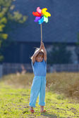 Boy with pinwheel — Stock Photo
