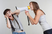 Girls with a megaphone — Stock Photo