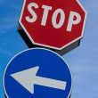 Stop signal with left arrow - Stock Photo