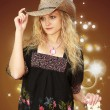 Cowgirl Tipping Her Hat - Stock Photo