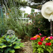 Garden and Hanging Sunhat - Stock Photo