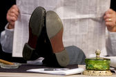 Feet on Desktop — Stock Photo