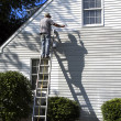 Man & Shadow Painting House — Stock Photo