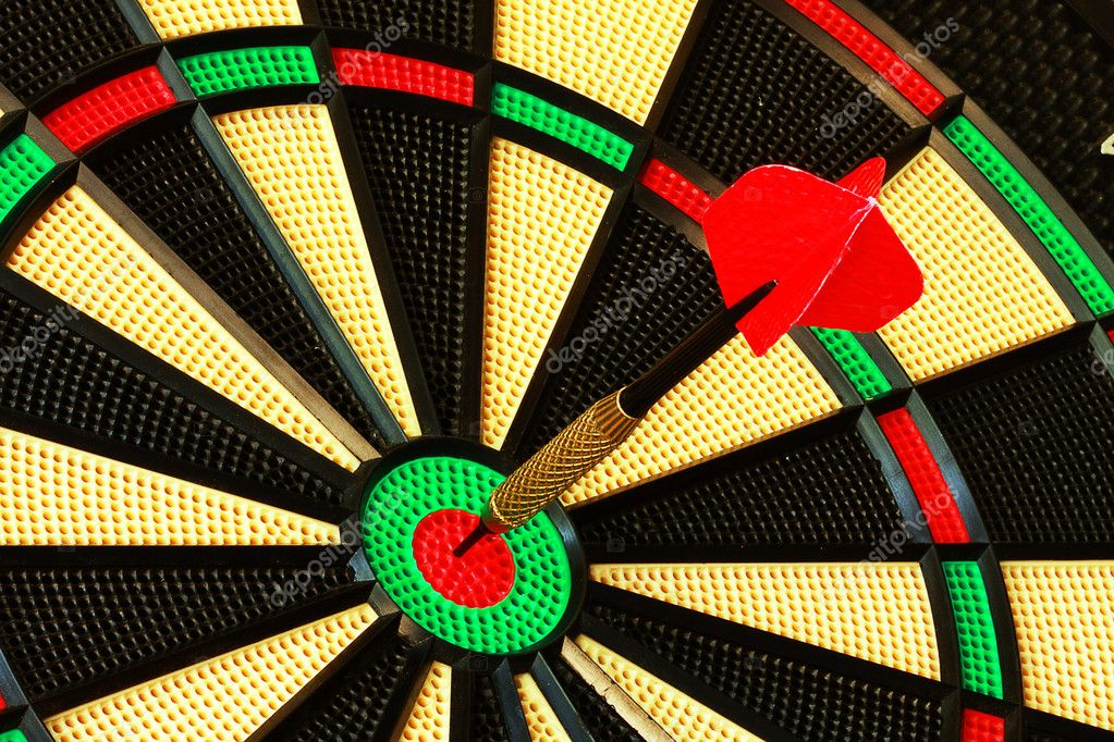 Single dart directly in center of bull's eye on dart board — Stock Photo #11226562