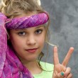 Stock Photo: Girl Giving Peace Sign