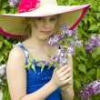 Girl enjoying Lilacs — Stock Photo