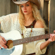 Stock Photo: Cowgirl Playing Guitar