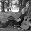 Resting Guitarist Outdoors - Stock Photo