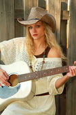Cowgirl Playing Guitar — Stock Photo