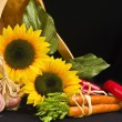 Country basket filled with sunflowers and veggies — Stock Photo