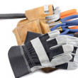 Construction tool belt ad gloves — Stock Photo #11213852