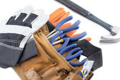 Close up shot of tool belt with wrench and hand gloves — Stock Photo