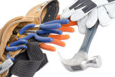 Tool belt with wrench hammer and gloves — Stock Photo