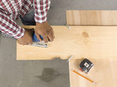 Cutting ply wood using a jigsaw — Stock Photo