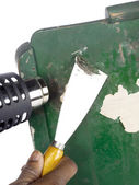 Heat gun and chisel removing paint — Stock Photo