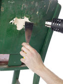 Removing paint by heat gun and chisel — Stock Photo