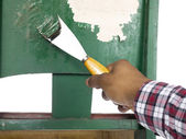 Person removing paint with chisel — Stock Photo